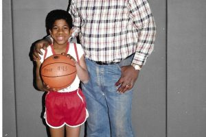 Ira Heyward with a young player he coached. Provided by Julia and Christa Heyward.